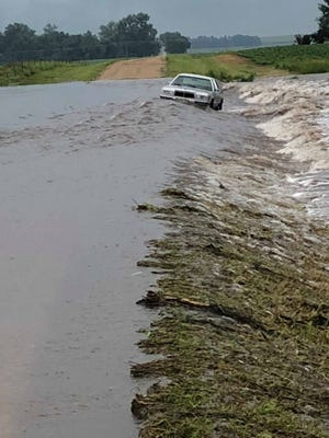A car became stuck due to flooding in Brookings County on Wednesday night.