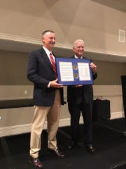 Treasure Coast's Tom Bakkedahl, left, stands next to state attorney Bruce Colton as he receives Florida's outstanding prosecutor of the year award by the Florida Prosecuting Attorneys Association.