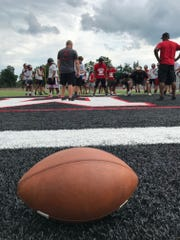 Marion Harding's football team goes through a drill in Harding Stadium during Monday's first day of practice.