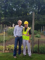 John Wickes meeting with a client. Wickes in an arborist