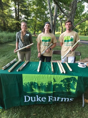 """Helping the public gain a better understanding of fireflies during Duke Farms' recent """"Firefly Festival"""" are, from left, RVCC graduate Deidre Supple, a former Duke Farms employee and current Rutgers University student; Anthony Sibaja; and Alec Mulder. RVCC Team member Alec Zarzor is not pictured"""