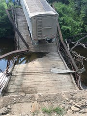 An overweight semi caused the collapse of a small, historic bridge near Northwood, N.D. Authorities say the semi, with a trailer load of dry beans, was traveling on the 56-foot-long, restricted-weight bridge over the Goose River on Monday when it gave way.