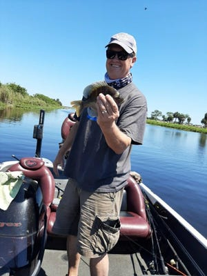 Fishing on Lake Okeechobee, near Buckhead Ridge, Van Kent, along with his son Parker,  caught a whole 'mess' of bluegill using crickets on ultra-light rods and reels.