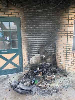 Police say a suspect, Arthur Grubbs, set a rackful of newspapers and plastic chairs on fire on the porch of this DeLand restaurant early on Tuesday.