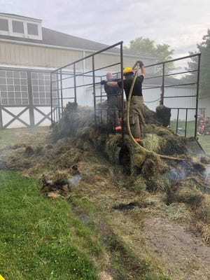 The only reported damage in a fire in the barn attached to Aurora's Inn Walden Tuesday evening was to this hay wagon and its contents, shown here after it was pulled out of the barn. No injuries were reported and horses in the barn were evacuated. The cause was undetermined.