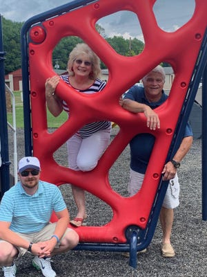 Street maintenance employee Ben Gundy, Mayor Cathy Beach and CouncilmanDan Beach admire the new playground equipment at Roswell.