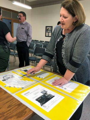 Grayson County Elections Administrator Deana Patterson shows off poster about the county's voting machines in this 2019 file photo