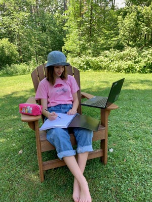 Ella LaFromboise, 12,  takes an online drawing class while enjoying the outdoors. She is the daughter of Kristin LaFromboise, CHaD Community Program Manager and is registered for Camp CHaD which starts on July 6.