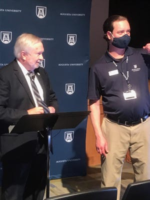 Augusta University President Brooks Keel prepares to address a virtual town hall on Tuesday with help from audiovisual technician John Rentiers.