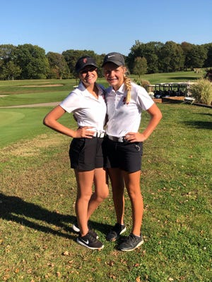 Pekin's Lauren Minkel, left, and Sydney Hubner celebrate their success at the Class 2A girls golf regional hosted by the Dragons at Lick Creek Golf Course. Minkel and Hubner qualified for sectionals as individuals.