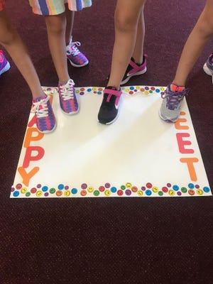 Recipients of the 'Happy Feet' promotion show off their new shoes thanks to the efforts of the Lincoln Emblem Club.