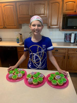 Reagan Cheney, who will be a sixth-grader at Beloit Elementary School, shows off some of the cupcakes she baked while raising more than $400 for the Mitchell County Food Pantry.