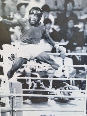 Ray Mercer leaps after Olympic victory.