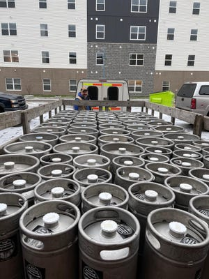 The move began by moving over 100 empty kegs, as pictured.
