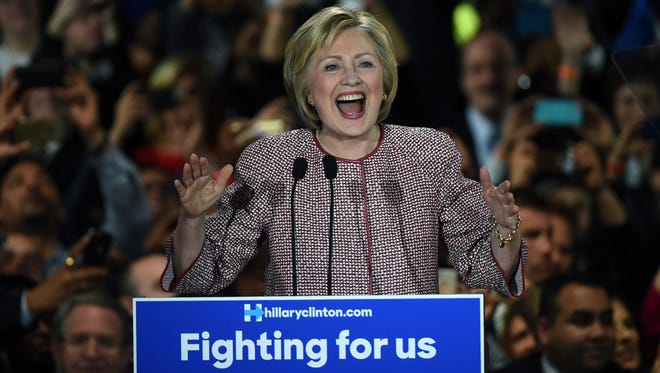 Democratic presidential candidate Hillary Clinton celebrates victory in the New York state primary on April 19, 2016 in New York City. Clinton won the New York primary, galvanizing her  bid to win the Democratic nomination for the White House. / AFP PHOTO / TIMOTHY A. CLARYTIMOTHY A. CLARY/AFP/Getty Images