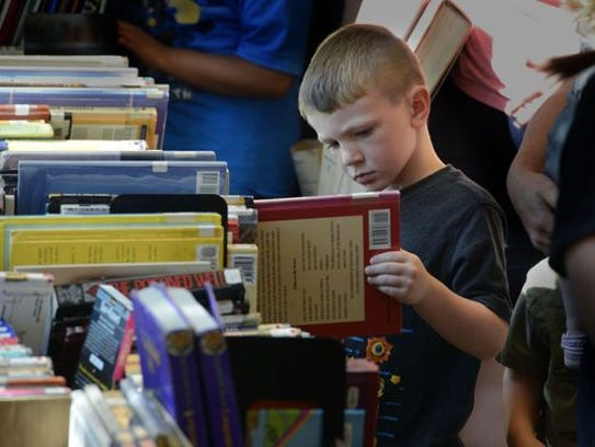 They came to read and buy at a previous $5 Blowout Book Sale at the West Florida Public Library in downtown Pensacola. The Friends of the WFPL will hold its spring book sale Friday through Sunday.