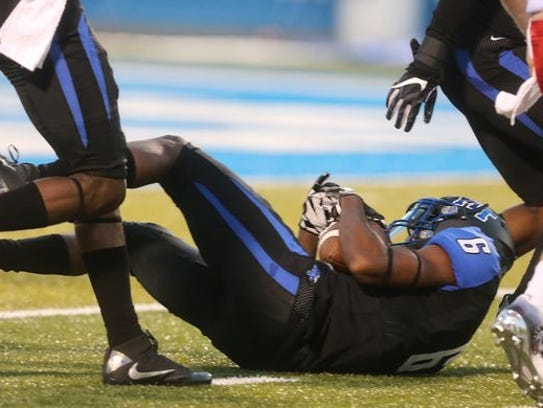 MTSU's Mike Minter (6) gains a turnover as he grabs
