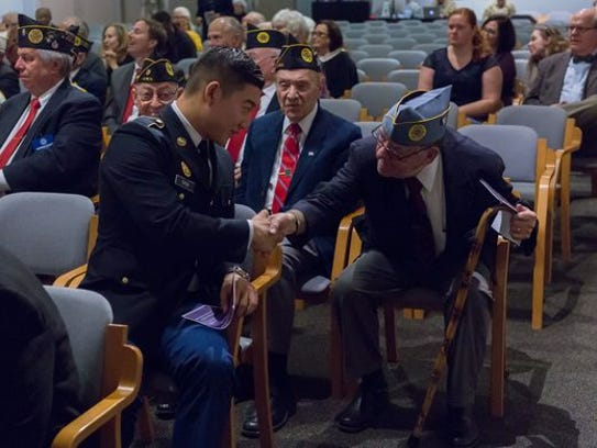 A group of Jewish war veterans thank Cadet Jay Choi