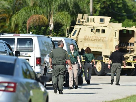 St. Lucie County Sheriff's Office investigators at