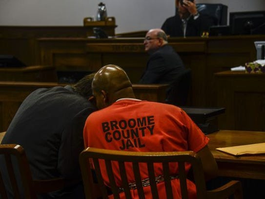 A jailed Aaron Powell speaks with his lawyer Tom Cline
