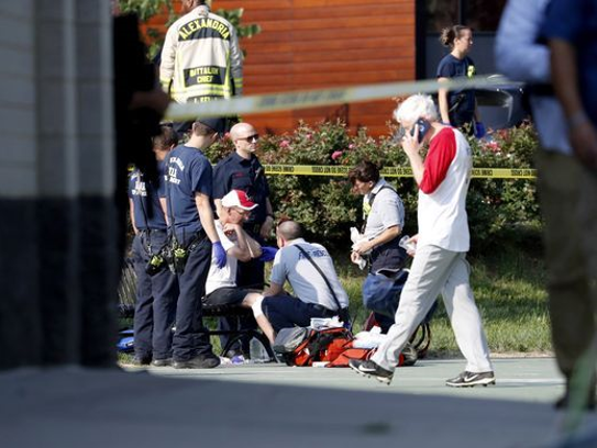 A person is treated by emergency workers as members