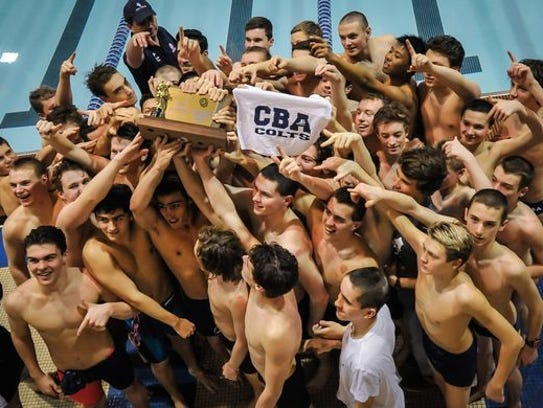 CBA celebrates with the NJSIAA trophy after their win