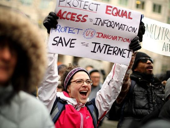 Demonstrators rally outside the Federal Communication Commission building to protest against the end of net neutrality rules Dec. 14 in Washington, DC.