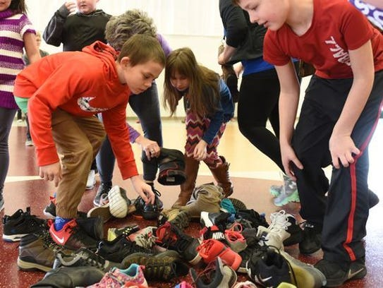 Students in Newark try to  find their friends' shoes