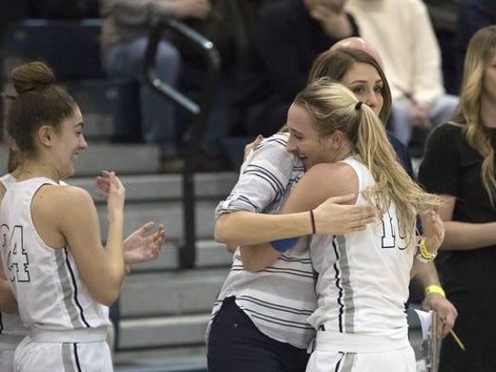 Dara Mabrey gives a hug to coach Lisa Kukoda as she