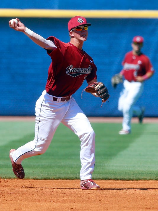 South Carolina short stop LT Tolbert (11) throws to first for the out against Kentucky during the second inning of the Southeastern Conference NCAA college baseball tournament, Friday, May 26, 2017, in Hoover, Ala. (AP Photo/Butch Dill)