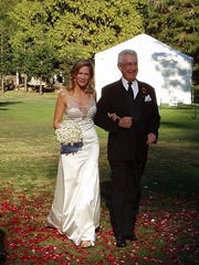 Wayne Perky walks Lady Booth down the aisle during her wedding to Ted Olson