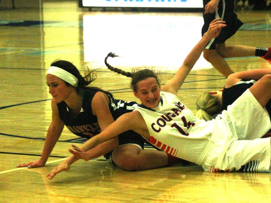 Franklin's Sarah Cramton and Garden City's Mikaela Smolar hit the floor in pursuit of a loose ball.