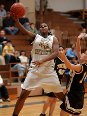 Former Rush-Henrietta girls basketball guard Shenise Johnson (#42) driving to the basket during a game against Greece Athena in 2006. Johnson is a member of the 2018 Section V Basketball Hall of Fame.