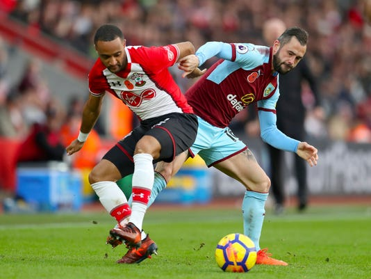 Southampton's Nathan Redmond, left, and Burnley's Steven Defour in action during their English Premier League soccer match at St Mary's Stadium in Southampton, England, Saturday Nov. 4, 2017. (Adam Davy/PA via AP)