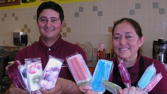 Mauricio Rosales and his mom, Ana Rosales, make nearly 50 flavors of popsicles at Sabor a Tocumbo, a South Mooney ice cream, beverage and dessert shop.
