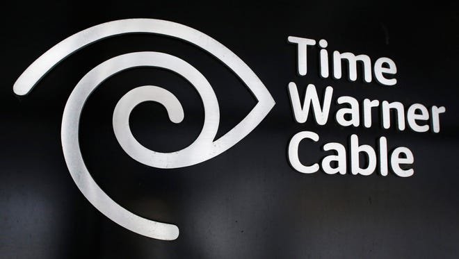 The Time Warner Cable corporate logo is displayed at a company store May 26, 2015 in New York.