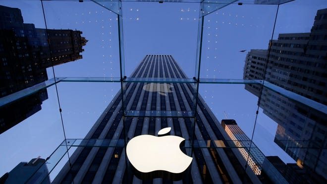 The Apple logo hangs in the glass box entrance to the company's Fifth Avenue store in New York.