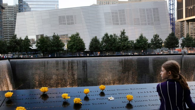 In this Sept. 8, 2013, file photo, Charlotte Newman, 8, visits the National September 11 Memorial and Museum in New York.