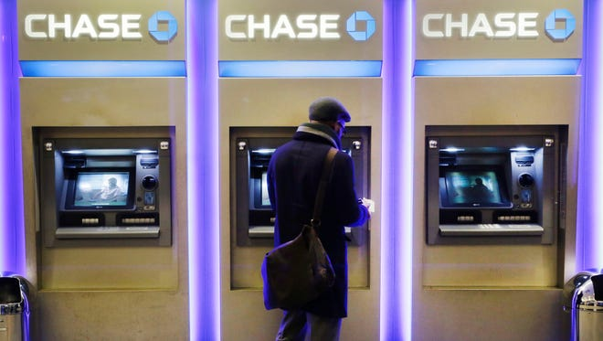 A customer uses an ATM at a branch of Chase Bank in New York on Jan. 14, 2015. A Boston company has taken technology developed at the Massachusetts Institute of Technology and turned it into special badges that hang around the necks of employees.