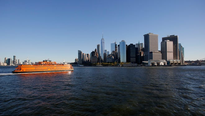 FILE - This Sept. 15, 2016 file photo shows the Staten Island ferry approaching lower Manhattan in New York. Riding the Staten Island Ferry is one of New York City's greatest free attractions, with wonderful views of Lower Manhattan and New York Harbor.