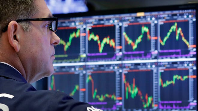 A trader works at the New York Stock Exchange on June 8, 2017.  (AP Photo/Mark Lennihan)