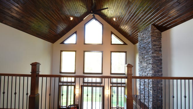 Floor-to-ceiling windows let in the light at 11043 West Lake Road near Rice.