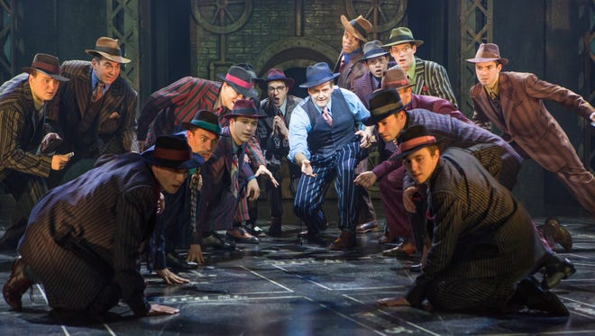 Evan Buliung, center, as Sky Masterson with members of the company in Guys and Dolls.
