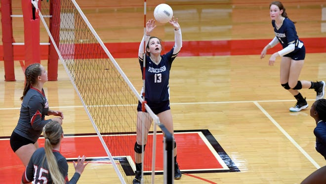 Roberson's Madelynn Bankard sets the ball in a match at Erwin High School on Tuesday, Sept. 26, 2017.