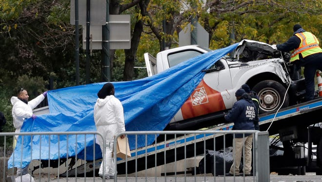 The Home Depot truck used in the bike path attack is removed from the crime scene Wednesday in New York.
