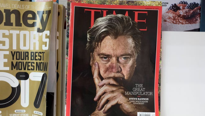 An issue of Time magazine is displayed on a New York newsstand on Nov. 16, 2017. Time Inc.'s board approved its sale for $1.8 billion to Meredith Corp.