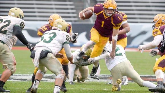 Cherokee quarterback Tye Mintz leaps against an attempted