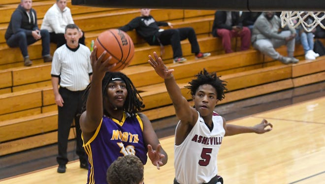 Asheville defeated North Henderson 81-56 in boys basketball at Asheville High School on Wednesday, Dec. 13, 2017.