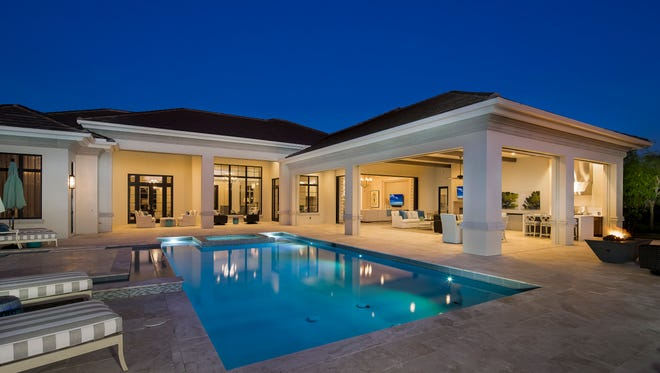 Stock's Aqualina model has an expansive outdoor living area which includes a fire pit.