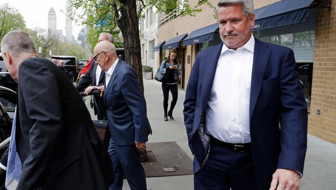 In this April 24, 2017 photo, Fox News co-president Bill Shine, right, leaves a New York restaurant.